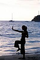 Woman exercising at Kata Beach, Phuket, Thailand ...