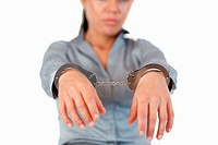 Guilty businesswoman with handcuffs with the camera focus on the hands