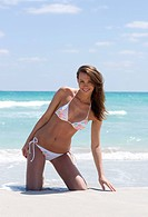 Woman in bikini on the beach                                                                                                                          ...