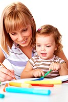 Photo of cute preschooler and her mother drawing