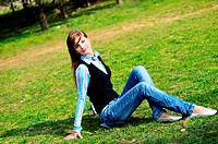 teen girl relaxing in the park