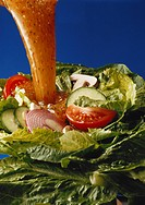 Dressing pouring on vegetable salad