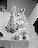 Wedding cake decorated with place setting