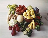 Fresh vegetables and fruit on wood grain