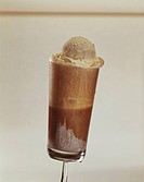 Scoop of chocolate ice cream in glass, close_up