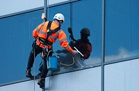 A window cleaner at work on an office building in Birmingham, UK