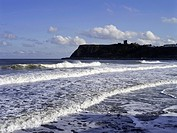 North Bay SCARBOROUGH NORTH YORKSHIRE Surfing waves breaking on shore and Scarborough Castle
