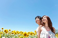 Young Couple in Sunflower Field