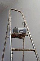 transistor radio on stepladder