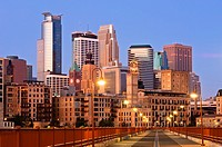Minneapolis skyline at dawn as seen from the Stone Arch Bridge   The Stone Arch Bridge is a former railroad bridge crossing the Mississippi River at S...