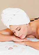 Beautiful woman relaxing at a spa isolated