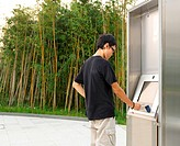 man using touch screen outdoor