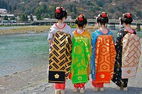 Tourists dressed up as geisha in front of the famous Togetsu-kyo bridge over the Katsura river, rear view