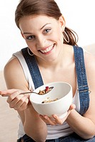 portrait of woman eating cereals