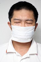Asian man in medical mask portrait eyes closed