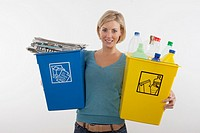 Woman with full recyling bins