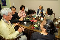 California, San Francisco, Chinatown, ethnic neighborhood, Grant Street, tearoom, tea house, cha guan, family, Asian, man, woman, mature adult, senior...