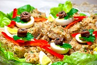 Food Recipes _ Three cereals pie decorated with eggs, fish, green salad and red pepper.