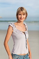 Smiling woman walking on beach