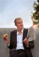 Businessman having breakfast outdoors