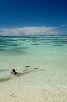 Seychelles, Island of La Digue. Young girl snorkeling at popular Anse Source D´Agent white sand beach.