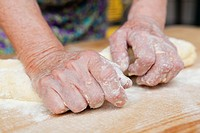 Close up of woman kneading dough