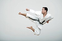 Middle_aged man practicing karate