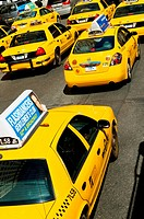 Famous New York yellow taxi cabs in motion