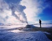 Geologist at Oskurholshver, hot spring at Hveravellir, Iceland
