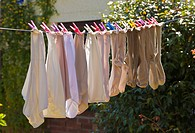 Knickers pants and socks on washing line. Colorful pegs