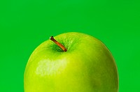Green apple against green background
