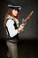 Young beautiful girl _ sea pirate with pistol