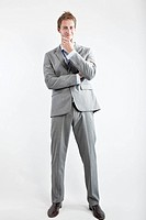 business man in grey suit on white background in studio