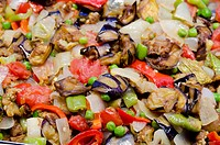 Turkey, Istanbul. Traditional Turkish food. Fresh grilled vegetables with onion, pepper, eggplant, peas.