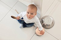 Baby playing with spoon and bowls