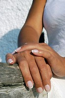 Close up of beautiful young female hands, with a french manicure