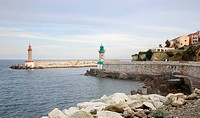 France, Corsica. Harbor entrance at Old Port in Bastia.