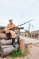 Retro style picture with soldier sitting on the bundles
