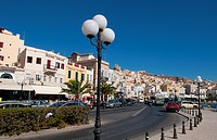 Hermoupolis, Syros Island, Greece. Main street shops and traffic.