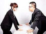 Businessman and woman war in office
