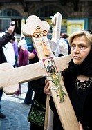 A Serbian pilgrim holding a wooden cross during the Good Friday procession