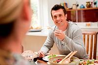 Couple eating healthy meal together at table