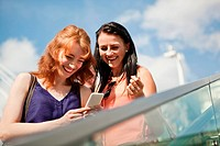 Two young women using a smart phone