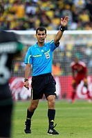 JOHANNESBURG, SOUTH AFRICA - JUNE 11: Referee Ravshan Irmatov Uzbekistan officiates the opening match of the FIFA World Cup between South Africa and M...