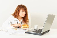 Young woman is going to have dinner sandwich at office