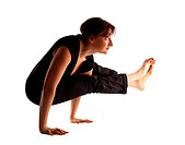 Mature woman stand on hands in yoga pose