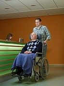 Germany, Hamburg, Man pushing senior man in wheel chair