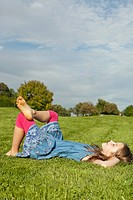 Germany, Bavaria, Girl relaxing in park