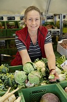 Germany, Upper Bavaria, Wolfratshausen, Mature woman buying vegetables from market