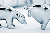Metal bull and bear figurine on white background